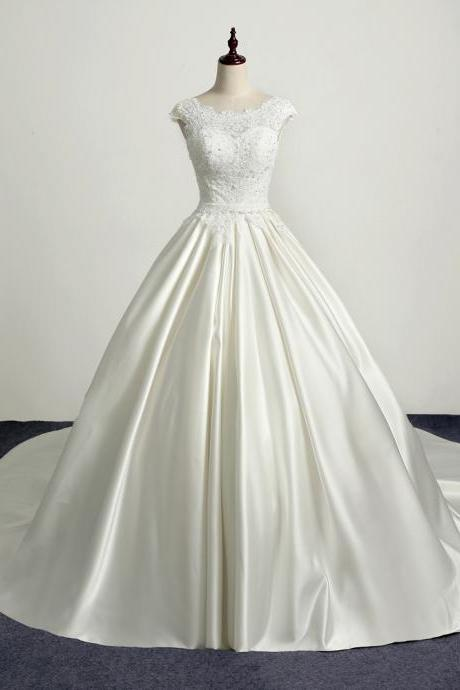 Ivory Floor Length Satin Wedding Gown Featuring Lace Bodice with Bateau Neckline, Open Back, Lace-Up Detailing and Chapel Train