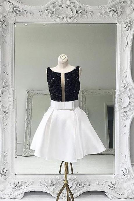 Short White Satin Dress Featuring Beaded Bodice With Bow Accent Belt